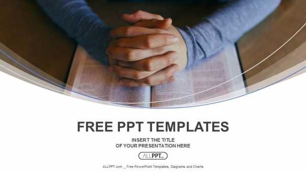 Hands of are folded in prayer over the book PowerPoint Templates  (1)